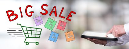 Big sale concept with man using a tablet. Man using a tablet with big sale concept Stock Photo