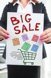 Big sale concept shown by a businesswoman Stock Photos