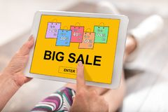 Big sale concept on a tablet. Woman using a tablet with big sale concept Stock Photography