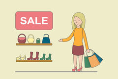 Big sale concept. Woman does shopping in the shop. Clothes checkout Royalty Free Stock Images