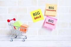 Big sale,big discounts,big savings. Selective focus of shopping cart or trolley with yellow sticky notes written with & x27;BIG SALE,BIG DISCOUNTS,BIG SAVINGS& Royalty Free Stock Photo