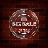 Big sale glass label on a brick background Stock Image