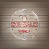 Big sale glass label on a wooden background Stock Photography