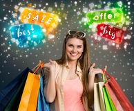 Big sale. Happy woman holding shopping bags, concept – big sale Stock Photo