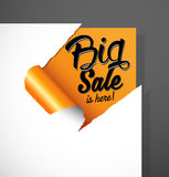 Big Sale is here text uncovered from teared paper corner. Royalty Free Stock Photos