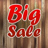 Big sale label over wood background. Royalty Free Stock Images
