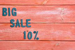 Big Sale Lettering And Discount Offer At Ten Percent, Metal Letters On Textured Wooden Boards Color Season 2019 Royalty Free Stock Images