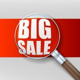 Big sale. Magnifying glass over red background. Royalty Free Stock Photos