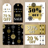Big sale printable card template with golden snowflakes design. Stock Photos