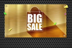 Big sale shopping bag silhouette with long shadow. Discount fifty percent. Horizontal bronze, gold, yellow metal plate. On steel background with round holes Stock Photo