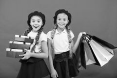 Big sale in shopping mall. small girl children with shopping bags. Birthday and christmas presents. Happy shopping. Online. International childrens day royalty free stock image