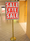 A big SALE sign on the entrance Stock Images