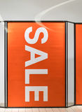 Big sale sign on red background poster in front of store Royalty Free Stock Photo