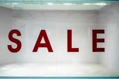 Big sale sign on shop window in department store. stock photo