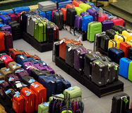 Big sale of suitcases for travel. Big sale in store. Travel suitcases of different sizes and colors and goods Stock Photography
