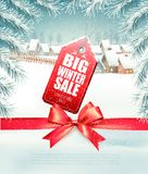 Big Sale Tag on christmas background with branches. Of tree and winter village. Vector Stock Photo