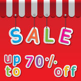 Big sale tag. Colorful paper sale up to 70% tags on red background and awning Royalty Free Stock Image