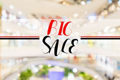 Big sale text on blur interior shopping mall Royalty Free Stock Image
