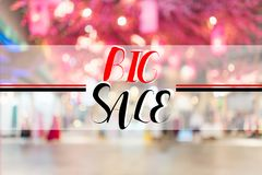 Big sale text on blur interior shopping mall Royalty Free Stock Photos
