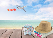 Big sale travel piggy bank with sunglasses relax on the beach. Big sale travel piggy bank with sunglasses relax on the beach holiday. concept saving money for Royalty Free Stock Photo