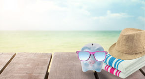 Big sale travel piggy bank with sunglasses relax on the beach. Big sale travel piggy bank with sunglasses relax on the beach holiday. concept saving money for Stock Photography