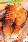 Big salmon steak. On a brown paper Royalty Free Stock Photo