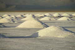 Big salt piles on Salar Uyuni salt lake Stock Images