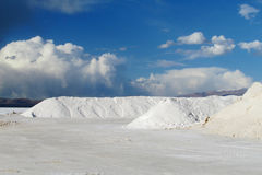 Big salt piles on Salar Uyuni salt lake Royalty Free Stock Image