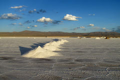 Big salt piles on Salar Uyuni salt lake Stock Photos