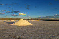 Big salt piles on Salar Uyuni salt lake Royalty Free Stock Photos