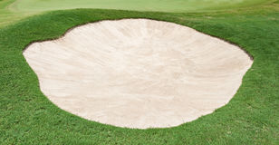 The big sand bunker on the beautiful golf course Stock Photos