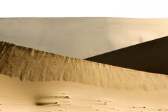 Big sand dune contrasts. Desert or beach sand textured background. Stock Image