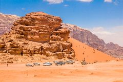 Big Sand Dune in majestic Wadi Rum. Aka Valley of the Moon, a protected nature reserve with dramatic sandstone mountains and granite rock. The largest wadi in stock images