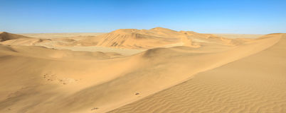 Big sand dunes panorama. Desert or beach sand textured background. Stock Photography