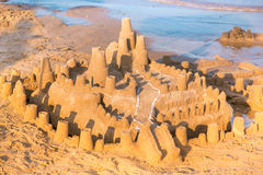 Big sandcastle on the beach Stock Image