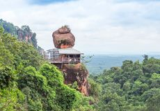 Big sandstone stand on cliff mountain in wat Phuthok or wat Jatiyakeeree viharn Bueng Kan Province, Thailand. In sunny day stock photo