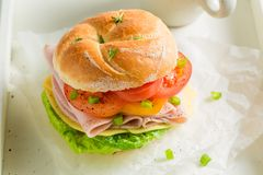 Big sandwich with ham, cheese and tea Stock Photography