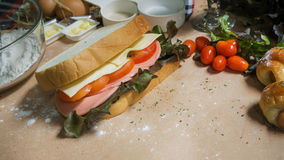 Big sandwich with ham, cheese and vegetables. Stock Image