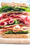 Big sandwich with ham, deli meat and vegetables Stock Photos