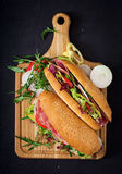 Big sandwich with ham, salami, tomato, cucumber and herbs. stock photos
