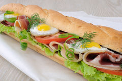 Big sandwich with ham, tomato and quail egg Stock Images