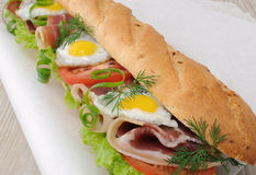 Big sandwich with ham, tomato and quail egg Royalty Free Stock Photo