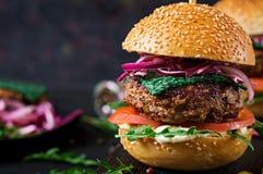 Big sandwich - hamburger burger with beef. Tomato, basil cheese and arugula royalty free stock images