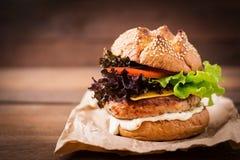 Big sandwich - hamburger with juicy turkey burger Royalty Free Stock Image