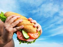 Big sandwich in hands Stock Images