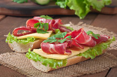 Big sandwich with raw smoked meat Stock Photos