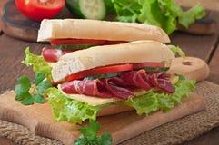 Big sandwich with raw smoked meat Stock Photo