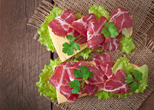 Big sandwich with raw smoked meat Royalty Free Stock Image