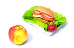 Big sandwich and a ripen apple Stock Images