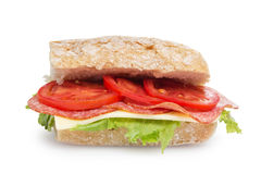 Big sandwich with salami cheese tomato and salad leaves on ciabatta bread Royalty Free Stock Photography